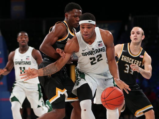 Michigan State guard Miles Bridges (22) dribbles past