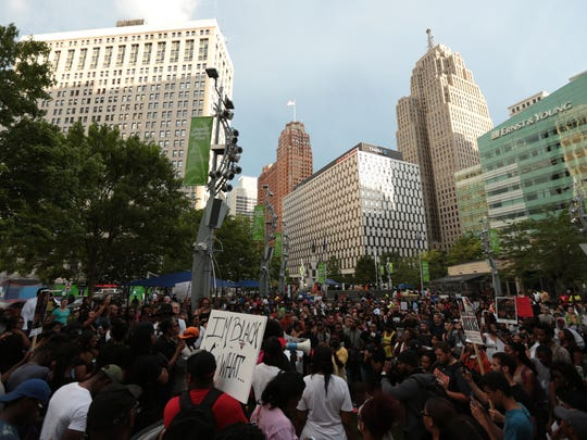 Protesters gather at Campus Martius in downtown Detroit on Friday July 8, 2016 while speaking out against recent shootings involving police officers that led to the deaths of Alton Sterling, 37, in Baton Rouge and Philander Castile, 32, in Falcon Heights, Minn. and the shooting of police officers in Dallas, TX.