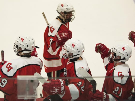 CVU's Richard Hall (7) celebrates his goal with the bench during the boys hockey game between the Champlain Valley Union Redhawks and the Rice Green Knights at Cairns Arena on Saturday afternoon January 23, 2016 in South Burlington.