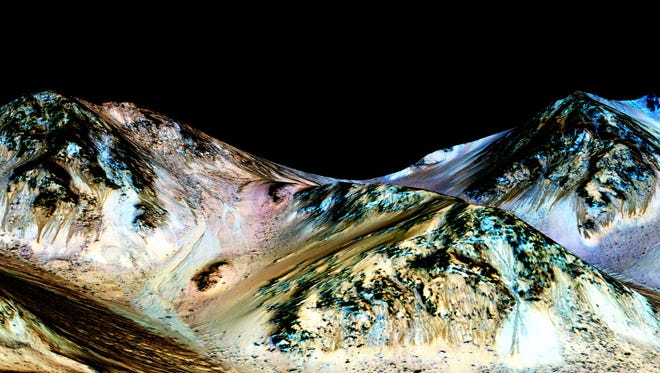 These dark, narrow, 100-meter-long streaks called recurring slope lineae flowing downhill on Mars are inferred to have been formed by contemporary flowing water. However, a recent study is throwing cold water on the hypothesis.