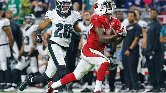 XXX Arizona Cardinals wide receiver John Brown (12) beats Philadelphia Eagles cornerback Cary Williams (26) for a touchdown late in their 24-20 win in their NFL game Sunday, Oct. 26, 2014 in Glendale.