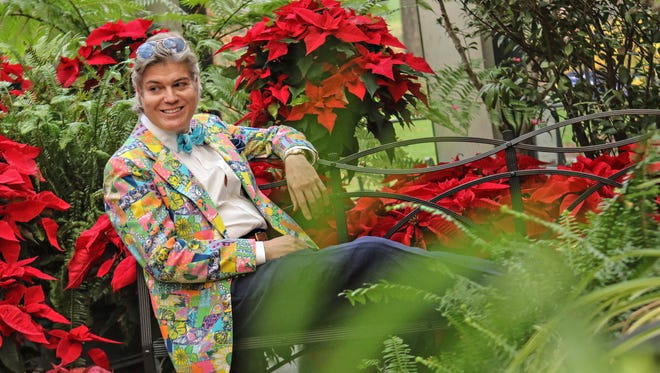 Harry Mack Truax II wears one of his vintage Lily Pulitzer jackets in Winterthur's convervatory, which this year features at 15-foot dried flower tree.