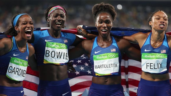 Aug 19, 2016; Rio de Janeiro, Brazil; Tianna Bartoletta , Allyson Felix , English Gardner and Tori Bowie (USA) celebrate after winning the women's 4x100m relay final in the Rio 2016 Summer Olympic Games at Estadio Olimpico Joao Havelange. Mandatory Credit: Erich Schlegel-USA TODAY Sports
