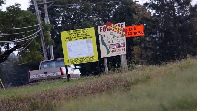 A sign advertising land that could be developed into a subdivision on Port Penn Road is shown Tuesday. A failed land preservation deal for the area had been in the works for years.