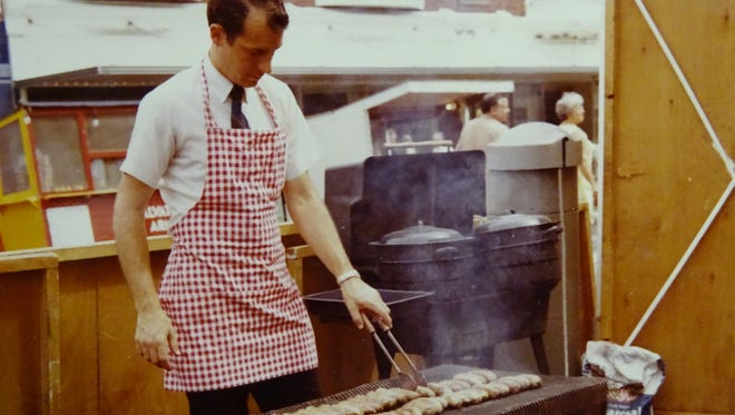A man grills bratwursts during the 1968 Bucyrus Bratwurst Festival, the second year the festival was held.