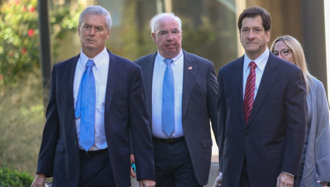Former Wilmington Trust President Robert Harra Jr. (second from left) arrives at the J. Caleb Boggs Federal Building.
