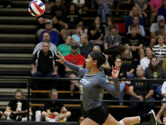 Rider's Alyssa Estrada-Hamby hits the ball over to