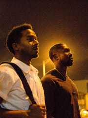 Andre Holland, left, and Trevante Rhodes in a scene