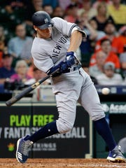 New York Yankees' Aaron Judge  hits into a force out but drives in a run during the ninth inning of a baseball game against Houston Astros, Thursday, May 3, 2018, in Houston.