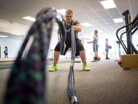 Nick Miller, 19, works out with heavy rope Friday,