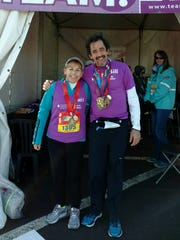 William Hiemcke, right, poses with Bernadette Wiggin at the end of the marathon race at Disney World.