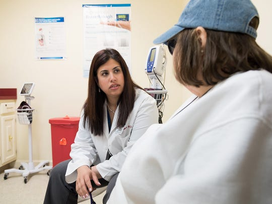 Dr. Anita Raghuwanshi, an endocronolgist with Beebe Healthcare in Lewes, consults with Portia Miller of Lewes about her type 2 diabetes on Monday afternoon. DOUG CURRAN/SPECIAL TO THE NEWS JOURNAL