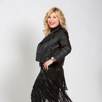 Raquel Koff, 58, in a sexy fitted turtleneck and knee-length BCBG fringe leather skirt from her Rodeo Drive boutique.