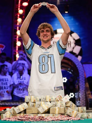 Ryan Riess holds up the championship bracelet after defeating Jay Farber for the $8.4 million payout in the World Series of Poker main event final table on Tuesday.