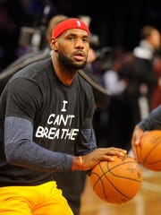 "Cavaliers forward LeBron James wears an "" I Can't Breathe"" T-shirt before a Dec. 8 game in Brooklyn."