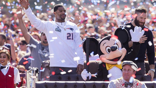 New England Patriots players Julian Edelman (right) and Malcolm Butler were joined by Mickey Mouse as they celebrated their team's Super Bowl XLIX championship victory with a special cavalcade down Main Street, U.S.A. at Disneyalnd park in Anaheim, Calif.