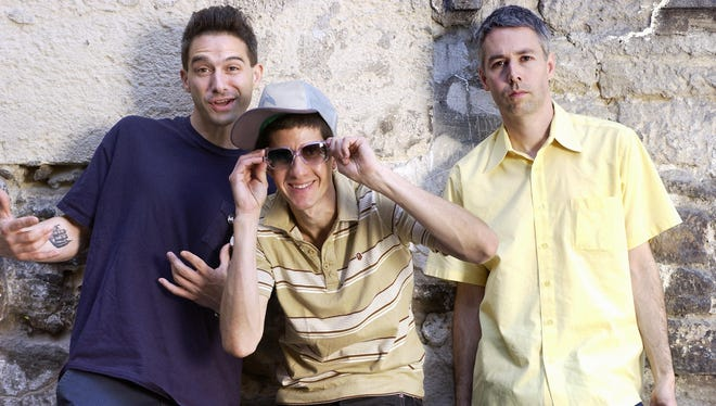 From left: Adrock aka Adam Horovitz, 38, Mike D aka Michael Diamond, 39, and MCA aka Adam Yauch, 37, respectively guitarist, drummer and bassist of the US band Beastie Boys, are pictured in Paris May 20, 2004.