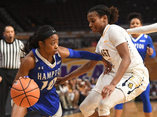Hampton guard K'lynn Willis drives towards the basket against North Carolina A&T guard Cinia McCray during an NCAA college basketball game in the finals of the Mid-Eastern Athletic Conference tournament Saturday, March 10, 2018, in Norfolk, Va. (AP Photo/Russell Tracy)