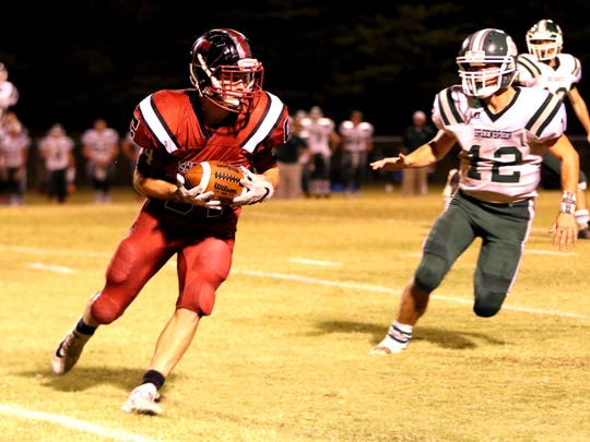 Cheatham County's Walker Bunce carries the football