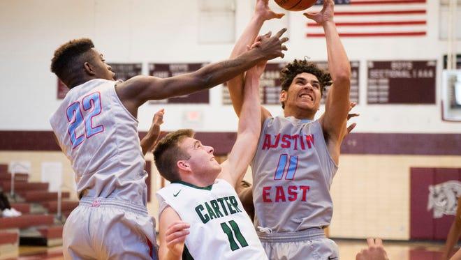 Austin-East's Darius gets the rebound over Carter's Adam Hurd during the Super 16 Tournament at Bearden High Schools on Thursday, December 29, 2016.