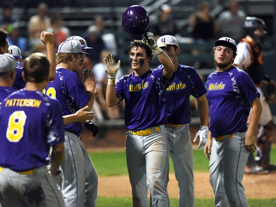 Clay Edler is congratulated by teammates after scoring the tying run during the fifth inning of Unioto's 9-2 loss to Marietta in a Division II district final on Wednesday at Bob Wren Stadium.