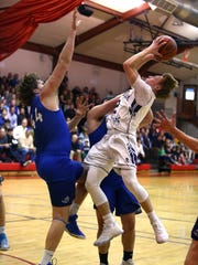 NV/Demarest center Connor Scaglione (44) defends against Mac Brehdal of Chatham in the Group 3 state boys basketball semifinal at East Orange Campus on Friday. Scaglione blocked four shots in the Norsemen's 45-34 loss.