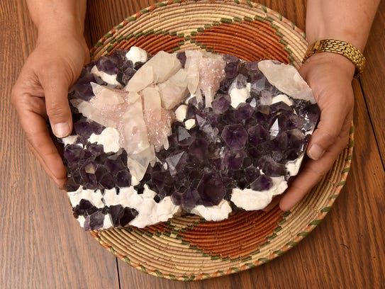 Laura Moody holds crystals, used in readings.