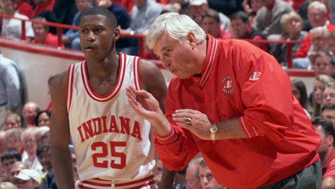 IU coach Bob Knight and A.J. Guyton talk strategy during a break in the action during overtime vs. Notre Dame in November 1999.
