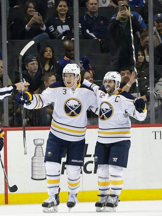 Buffalo Sabres' Mark Pysyk (3) and Brian Gionta (12) celebrate after Gionta scored during overtime in an NHL hockey game against the New York Islanders on Saturday, April 9, 2016, in New York. The Sabres won 4-3. (AP Photo/Frank Franklin II)