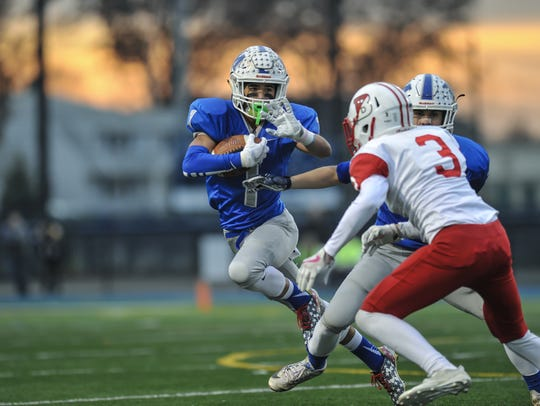 Middlesex running back Devin Lanza makes a move to