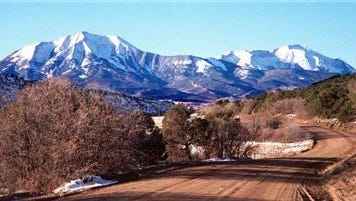 The Forest Service has agreed to consider closing 500 miles of roads for motorized vehicles that land managers improperly allowed in mountains west of Front Range cities.