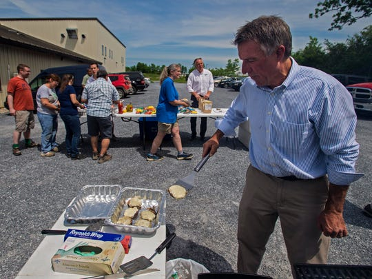 Republican candidate for governor Lt. Gov. Phil Scott cooks hamburgers during a campaign visit at Maple Landmark Woodcraft in Middlebury on Wednesday, June 1, 2016.