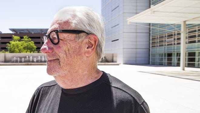 Backpage co-founder Michael Lacey walks out of the Sandra Day O'Connor Federal Courthouse in Phoenix on April 13, 2018.