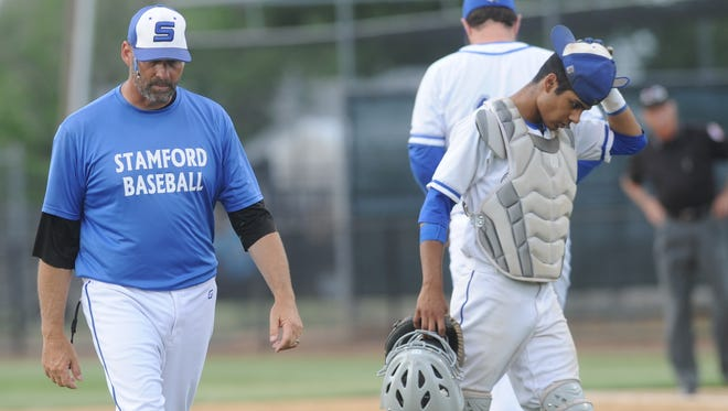 Stamford baseball coach Jeremy West, left, walks off the mound after visiting with his pitcher during the Bulldog's Region I-2A quarterfinal series' opener against Hawley on Friday, May 18, 2018 at HSU's Hunter Field. Hawley won 12-2.