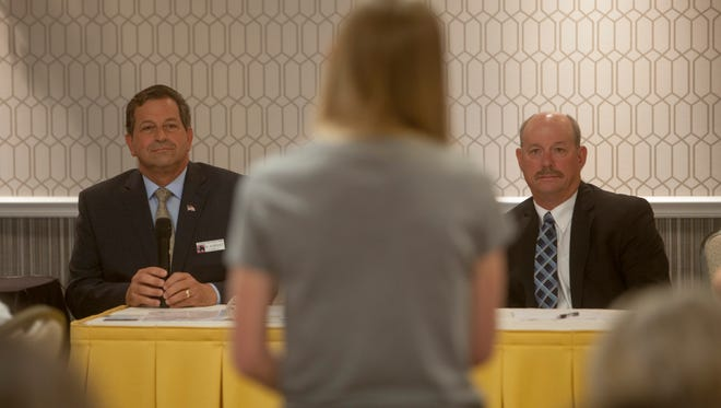 Gil Almquist (left) and Allen Davis debate in a forum organized by the Washington County Republican Women at the Abbey Inn Thursday, May 3, 2018.