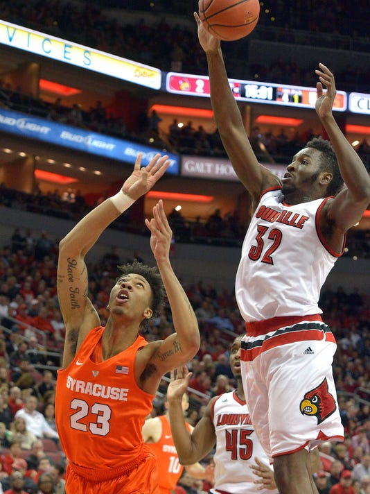RETRANSMISSION TO CORRECT DAY TO WEDNESDAY - Syracuse's Malachi Richardson (23) attempts a off balance shot past the defense of Louisville's Chinanu Onuaku (32) during the first half of an NCAA college basketball game, Wednesday, Feb. 17,  2016, in Louisville Ky. (AP Photo/Timothy D. Easley)