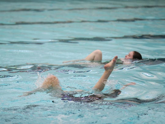 A group of freshman girls practice their performance for the Valley High School Tigerlillies synchronized swim team water show, on Tuesday, March 29, 2016, at the Valley High School pool.
