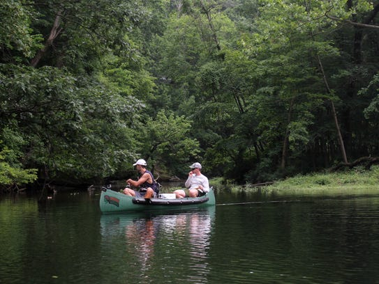 Fishermen in a canoe enjoying a nice afternoon on the