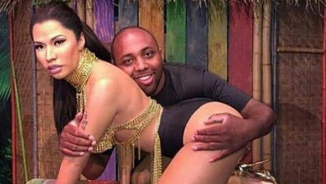 Instagram photo of a fan with Nicki Minaj's wax model.