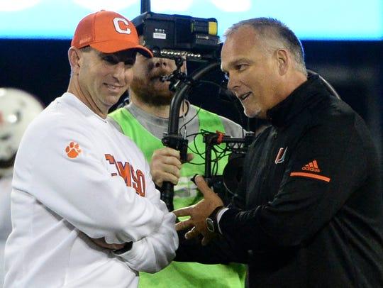 Clemson head coach Dabo Swinney, left, and Miami head