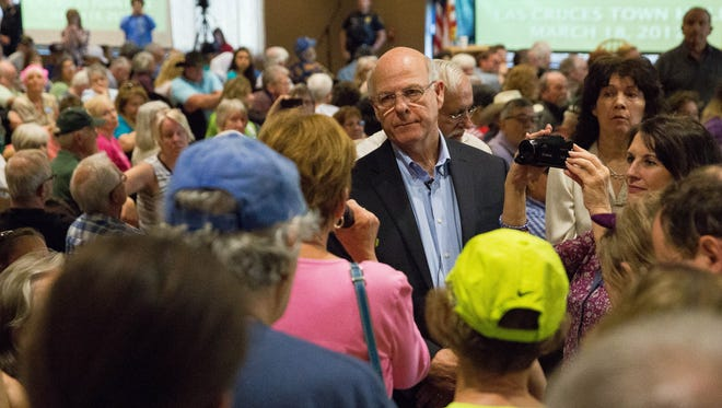 US Representative Steve Pearce, takes a question from Jean Roach, a part time Las Crucen about President Trumps comments on the press and freedom of the press, at the New Mexico Farm and Ranch Heritage Museum, Saturday, March 18, 2017. The town hall had been called for by Indivisible and other groups in response to what they saw as the lack of concern on the part of Pearce to his constitute in the 2nd congressional district.