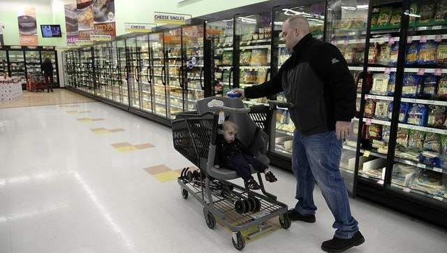 Josh Hundsrucker, of Howard, and his son William use a Caroline's Cart as they shop at Festival Foods in Suamico. William has cerebral palsy.