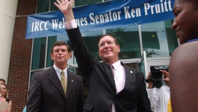 Indian River Community College President Dr. Edwin Massey, left, stands by as Senator Ken Pruitt waves to students and faculty in 2005 while making a stop at the IRCC campus in Fort Pierce to promote the Bright Futures Express tour supporting education.