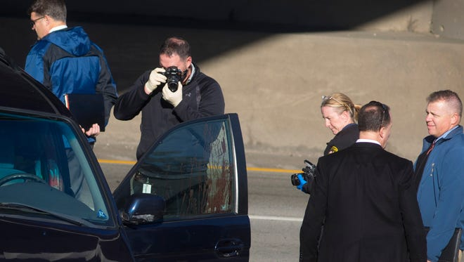 Wed., Nov. 8, 2017: Cincinnati Police investigate a crash on southbound Interstate-75 at the 8th Street viaduct after a police chase ended with a crash. The driver was found with a self-inflicted gunshot wound, according to police. The pursuit began after police say a man matching the description of Ronald Foster showed up to the Cincinnati police impound lot.