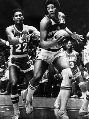 Wes Unseld of the Washington Bullets takes in an offensive rebound against John Drew (22) of the Atlanta Hawks during second period action at the Capital Centre in Landover, Md., Jan. 30, 1979.