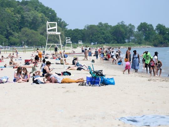 People enjoy the warm weather at Bradford Beach on the lakefront in Milwaukee.