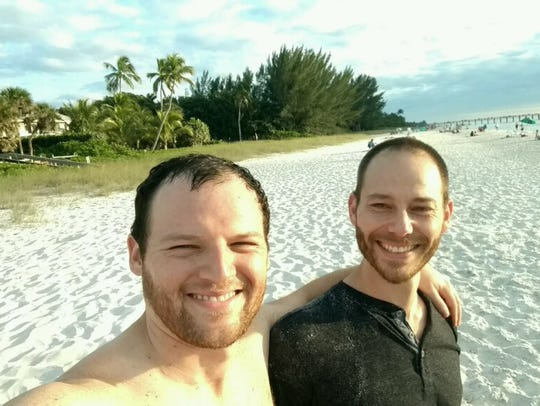 Brett Greenhill, right, on the beach the day of the