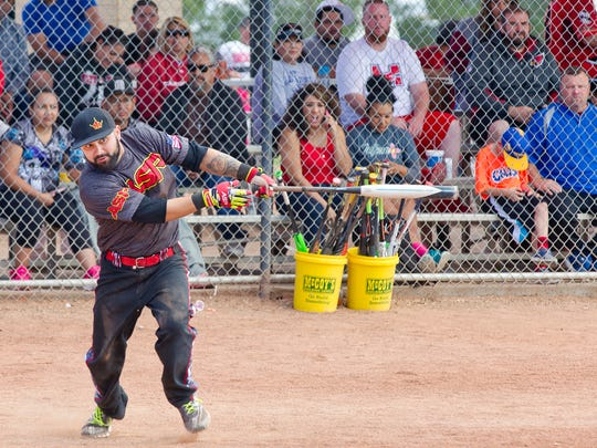 Gabriel Iuttalle Jr. from El Paso, watches a line drive fall as he makes hie way to first base during The Whole Enchilada Softball Tournament Sunday morning at Maag Park.
