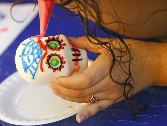 Sugar skulls are decorated to commemorate deceased