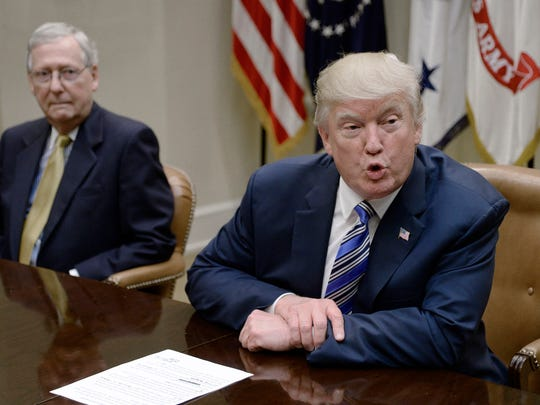 President Donald Trump speaks as Senate Majority Leader Mitch McConnell, left, looks on during a meeting with House and Senate leadership on June 6, 2017, in the Roosevelt Room of the White House in Washington, D.C. (Olivier Douliery/Abaca Press/TNS)